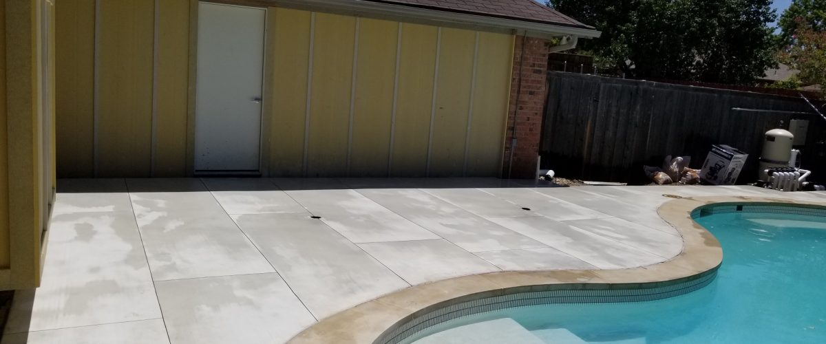 Concrete patio around a pool