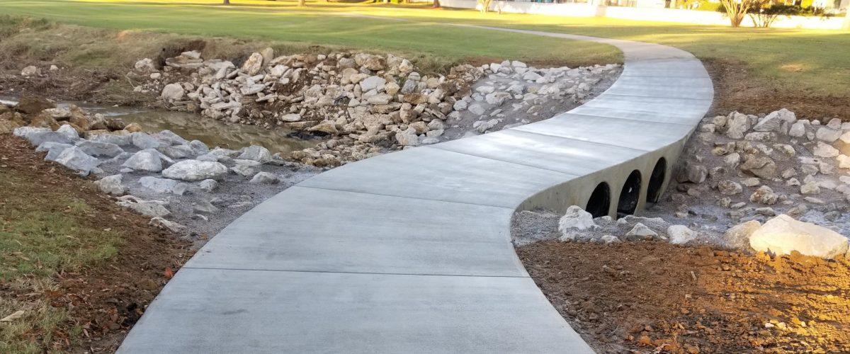 Concrete walkway over a creek